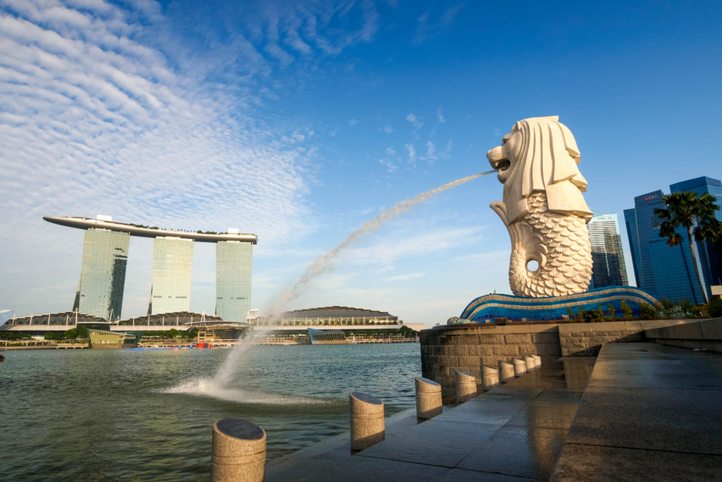 Singapore City, Singapore - June 20, 2014: View of Merlion Statue at Marina Bay in Singapore with tourists and Singapore Skyline in background.